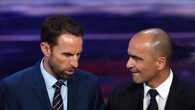Gareth Southgate, Manager of England speaks to Roberto Martinez, Manager of Belgium