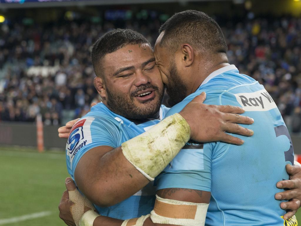 Tolu Latu and Sekope Kepu of the Waratahs hug after the Super Rugby quarter-final match between the NSW Waratahs and the Highlanders at Allianz Stadium in Sydney, Saturday, July 21, 2018. (AAP Image/Craig Golding) NO ARCHIVING, EDITORIAL USE ONLY