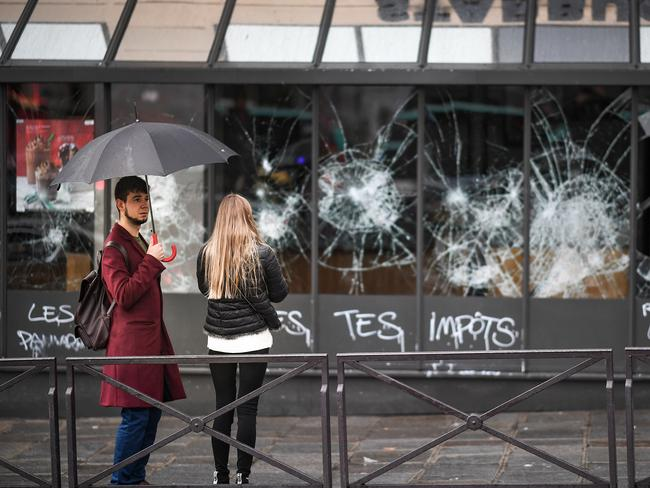 Graffiti and broken windows of a Starbucks at Gare Saint Lizare following a fourth week of protests against rising fuel prices. Picture: Jeff J Mitchell/Getty Images