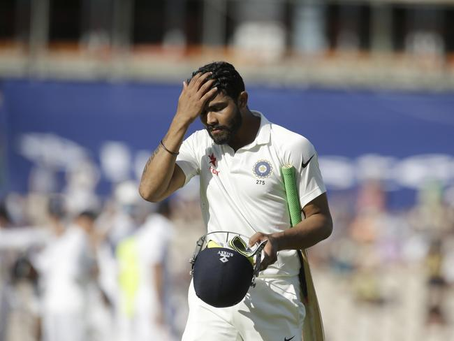 India's Ravindra Jadeja walks off the field of play after losing his wicket LBW off the bowling of England's James Anderson.