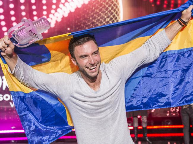 Winner ... Mans Zelmerlow from Sweden holding the Eurovision trophy. Picture: Ella Pellegrini