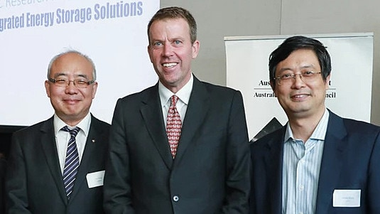 Education Minister Dan Tehan, centre, with Thousand Talents recipient Dong Zhaoyang, left, and Guoxiu Wang in a picture first posted online in February.