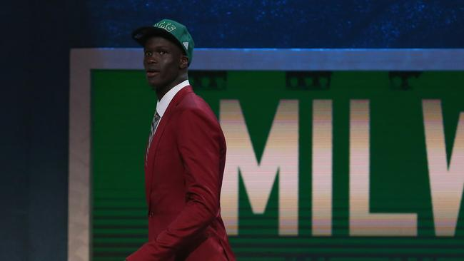 Thon Maker walks off stage after being drafted 10th overall by the Milwaukee Bucks.