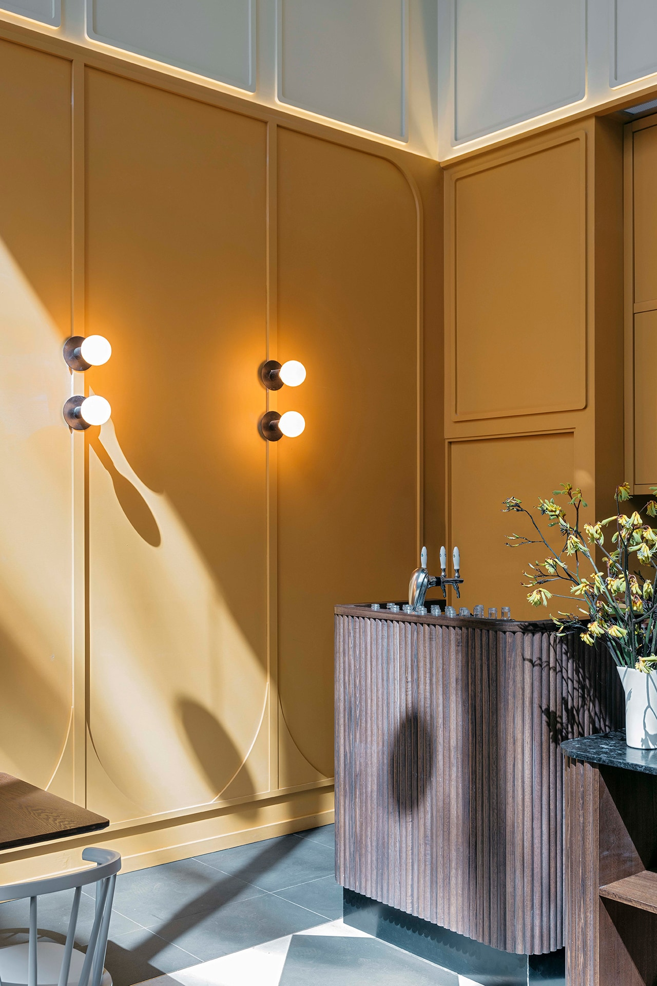 Relaxed optimism: a new café in Melbourne embraces sunny shades of marigold