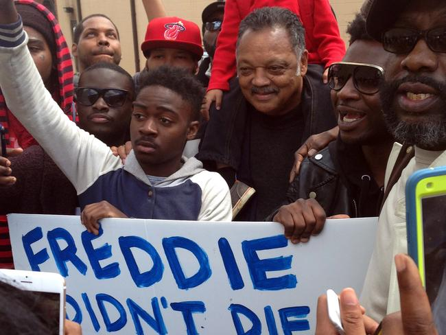 Peace ... The Rev. Jesse Jackson stands with demonstrators in the aftermath of rioting following Monday's funeral for Freddie Gray, who died in police custody. Picture: AP Photo/David Dishneau
