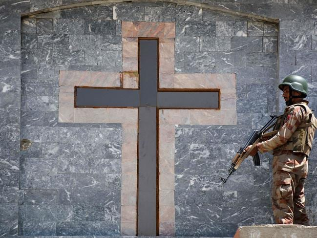 A Pakistani soldier stands guard on the roof of a Methodist Church during the Easter service in Quetta on April 21, 2019. Picture: AFP