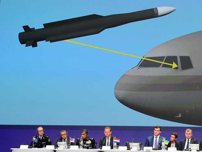 Members of a joint investigation team present the preliminary results of the criminal investigation into the downing of MH17. Picture: AFP