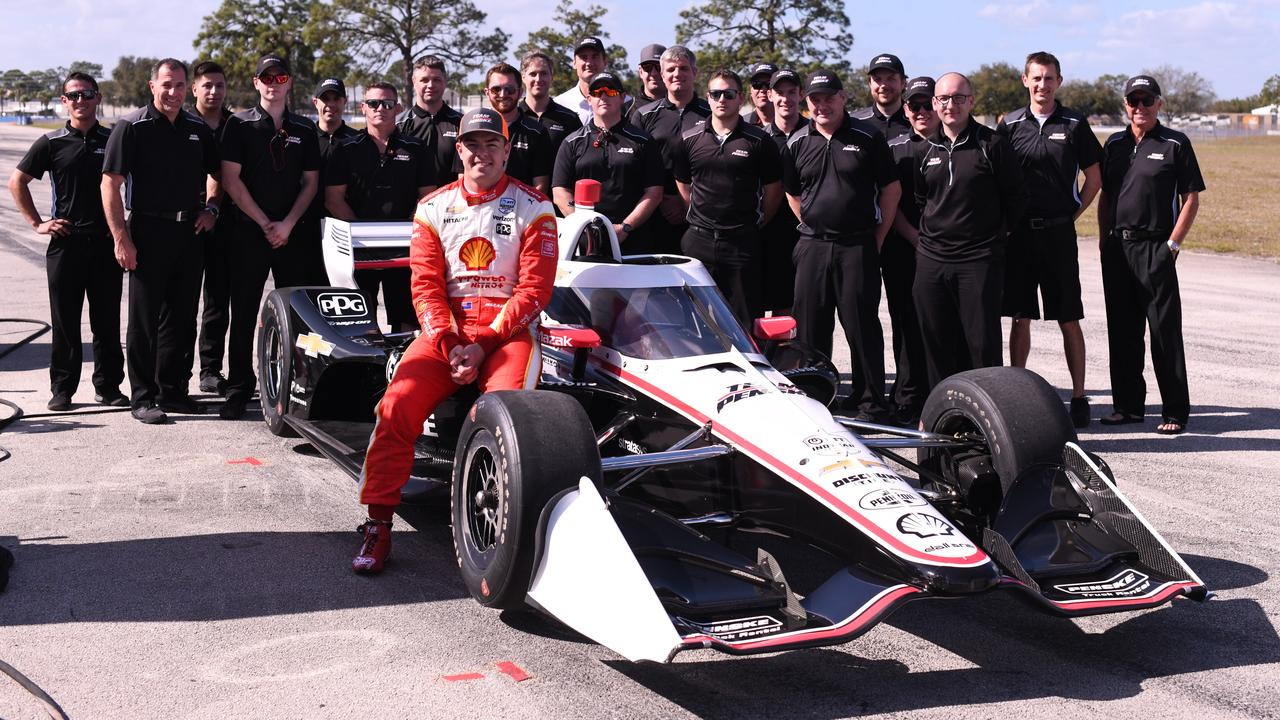 Scott McLaughlin poses with the Penske IndyCar crew at Sebring last month.