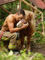 Victoria firefighter Lincoln with a Healing Hooves rescue horse. Picture: Brett Cunliffe/Australian Firefighters Calendar
