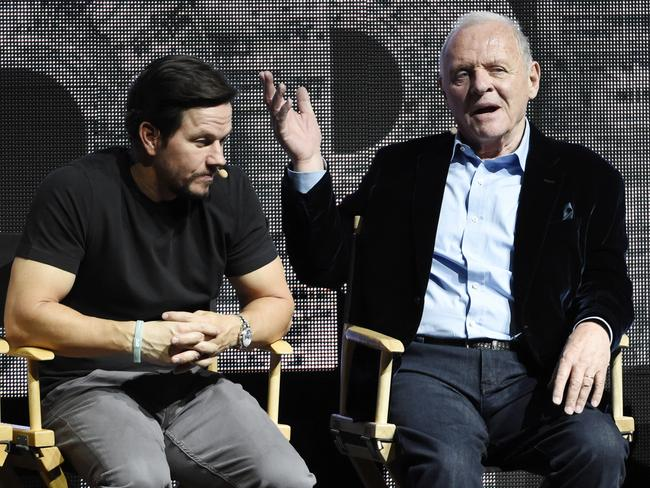 Sir Anthony Hopkins (left) joins Mark Wahlberg in the new Transformers: The Last Knight. Picture: Chris Pizzello/Invision/AP