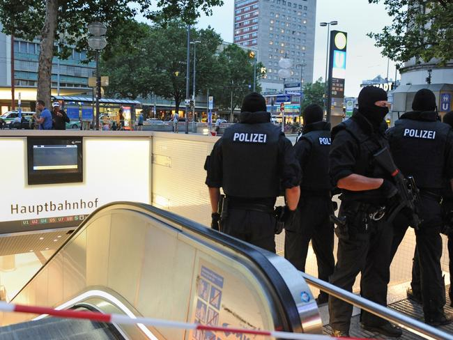 Special police forces stand by the entrance to Munich's main subway station. Picture: AFP