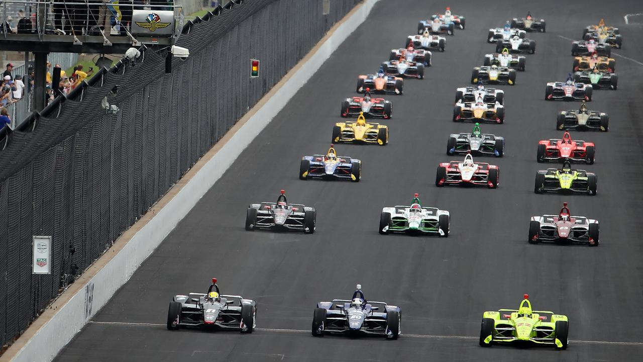 Simon Pagenaud (bottom right) leads the field at the start of the Indy 500 in May.