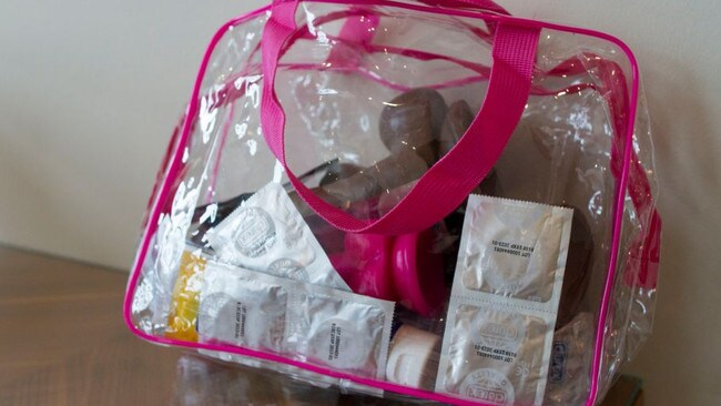 Chloe's work bag of sex toys and condoms, including ones for 'larger and smaller' guys. Picture: Maroon Productions