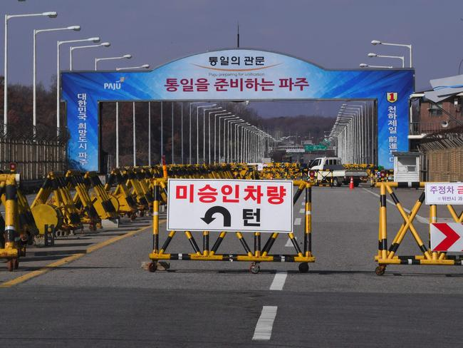 A barricade is set on the road leading to the truce village of Panmunjom at a South Korean military checkpoint in the border city of Paju near the Demilitarised Zone (DMZ). Picture: AFP/Jung Yeon-Je