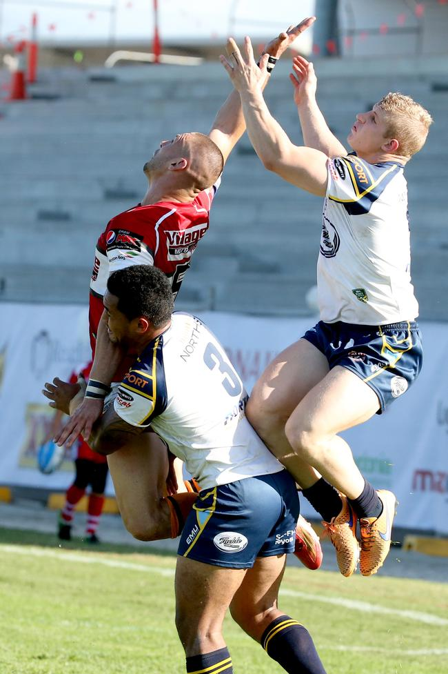 Intrust Super Cup. Redcliffe Dolphins Curtis Johnston flies with Norths Devils David Faamita and Rogan Dean - Picture: Richard Walker