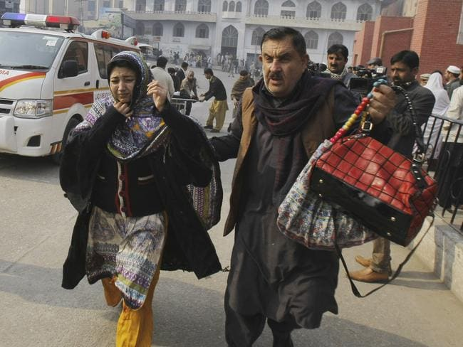 Catastrophic ... Parents rush to the hospital to find their children. Picture: AP/Mohammad Sajjad