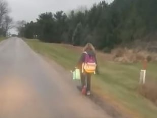 The dad followed her by car to accompany her 8km walk on Monday. Picture: Matt Cox