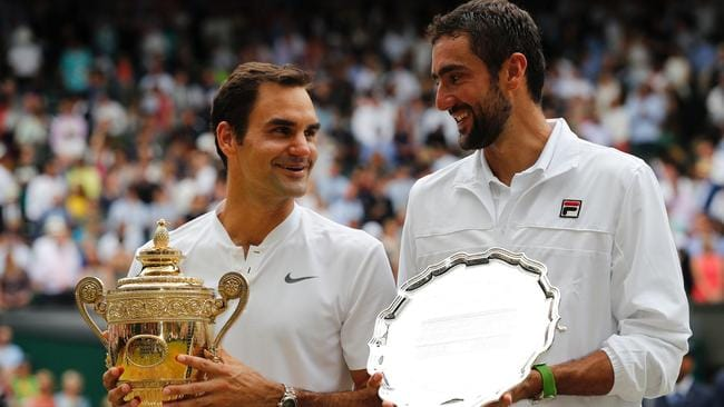 Federer with runner-up Marin Cilic.