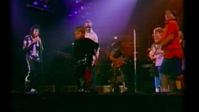 Robson (centre) dances on stage with Jackson during his Australian tour.
