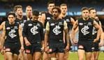 Marc Murphy of the Blues (second from right) leads his team from the ground after the Round 9 AFL match between the Carlton Blues and the Melbourne Demons at the MCG in Melbourne, Sunday, May 20, 2018. (AAP Image/Julian Smith) NO ARCHIVING, EDITORIAL USE ONLY