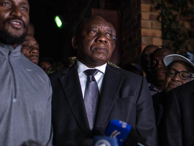 South Africa President Cyril Ramaphosa (centre) said his country wasn't following Zimbabwe's example of violence. Picture: Mujahid Safodien/AFP