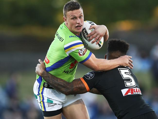 Jack Wighton of the Raiders is tackled by Kevin Naiqama of the Tigers during the Round 15 NRL match between the Wests Tigers and the Canberra Raiders at Campbelltown Stadium in Sydney, Sunday, June 17, 2018. (AAP Image/Brendon Thorne) NO ARCHIVING, EDITORIAL USE ONLY