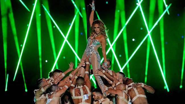Jennifer Lopez reaches for the stars during halftime at Monday's Super Bowl. Picture: USA Today