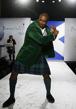 "Former MLB New York Yankee Bernie Williams walks down the runway in a kilt during a ""Dressed To Kilt"" fashion event in New York."