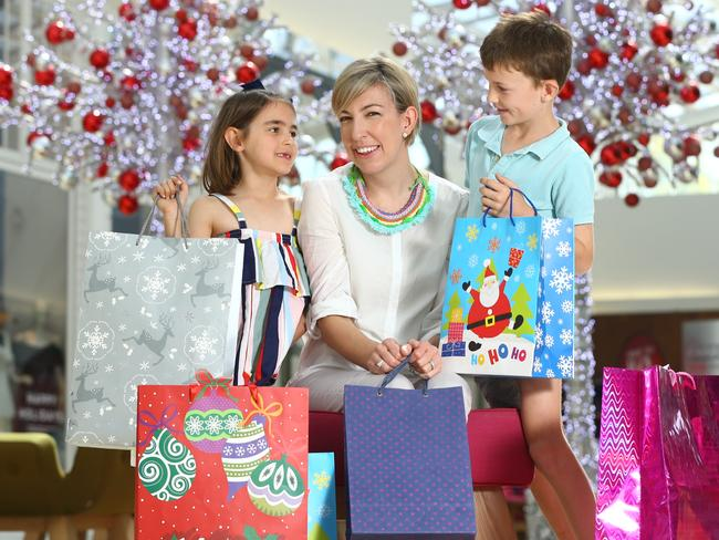 Carly Davies and her two children Grace, 6 and Evan, 8, doing their Christmas shopping. Picture: Tait Schmaal.