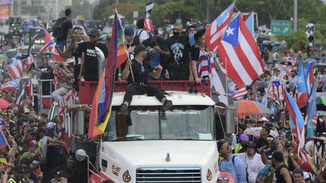 Here We Go! Martin happily took part in the protest on the top of a Mack truck. Picture: AP