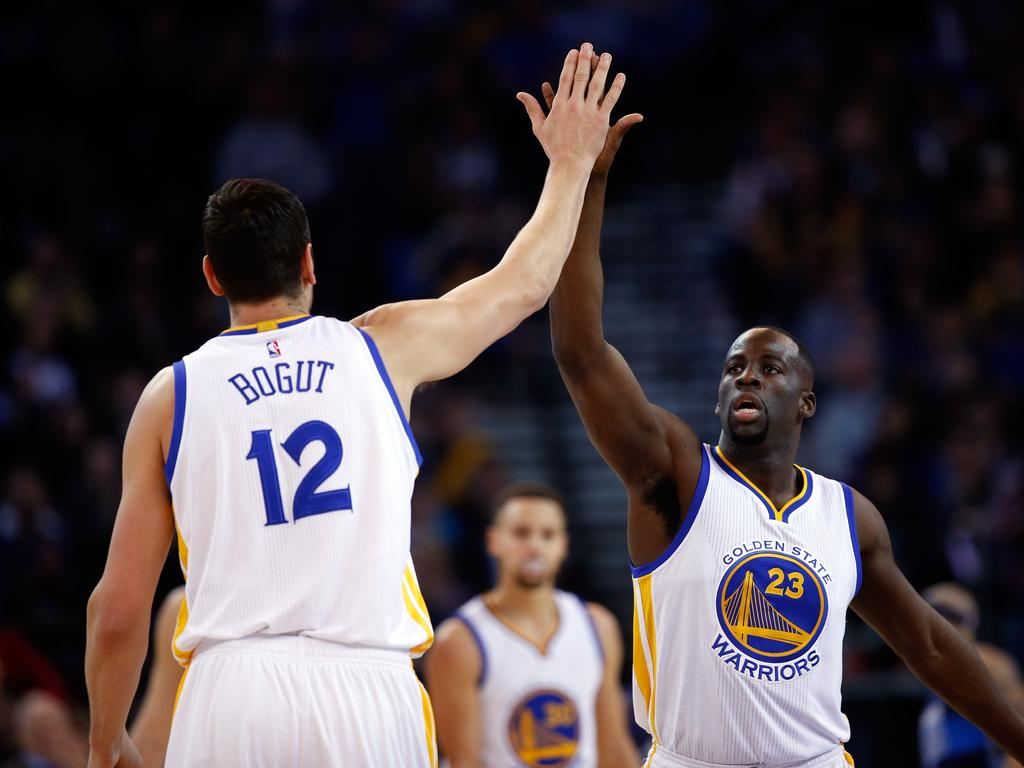 OAKLAND, CA - JANUARY 27: Draymond Green #23 high-fives Andrew Bogut #12 of the Golden State Warriors during their game against the Dallas Mavericks at ORACLE Arena on January 27, 2016 in Oakland, California. NOTE TO USER: User expressly acknowledges and agrees that, by downloading and or using this photograph, User is consenting to the terms and conditions of the Getty Images License Agreement. (Photo by Ezra Shaw/Getty Images)