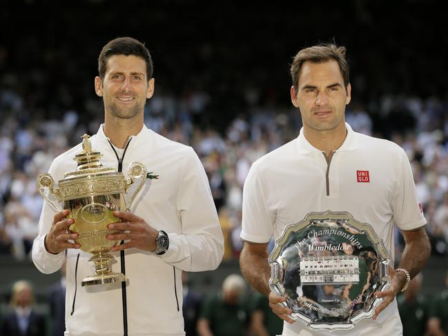 Not the trophy Roger wanted. (AP Photo/Tim Ireland)