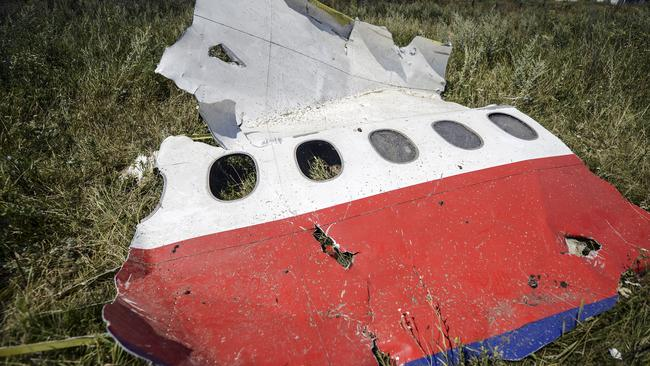 Shock find ... Plane debris from the downed MH17 flight was found strewn near the village of Hrabove, Ukraine. Picture: AFP/Bulent Kilic