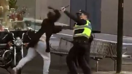 The man attacking a police officer in Bourke St on Friday.