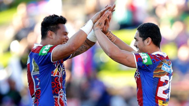 Knight's Joey Leilua and Sione Mata'utia celebrate the win.