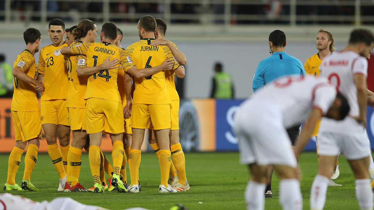 Syria players are dejected following Tom Rogic's (23) late winning goal. (Photo by Francois Nel/Getty Images)