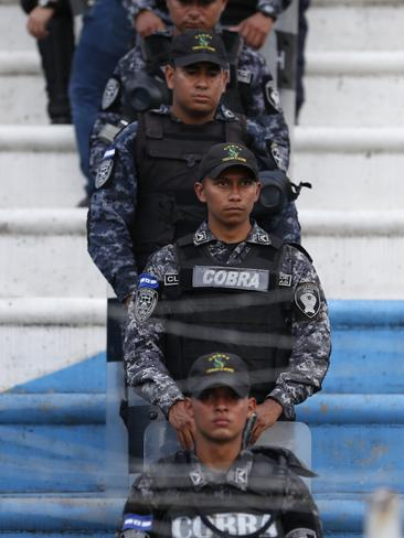 A line of riot police separates the stands into Mexico and Honduras fan zones.
