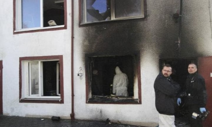 Forensic and other police experts examine the scene of the blaze. Picture: APSource:AP
