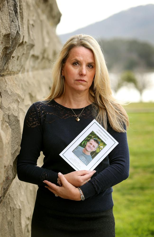 Lisa Alward, the sister of Chris Stiles, holds a photograph of her brother. Chris took his own life after being exposed to Mefloquine in Timor.