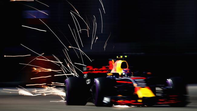 Sparks fly from Max Verstappen's Red Bull in the final practice in Singapore.
