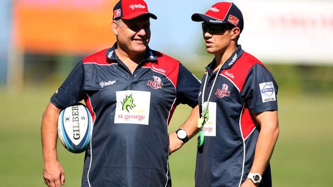 Ewen McKenzie with assistant coach Matt Taylor during a Reds training session in 2012.