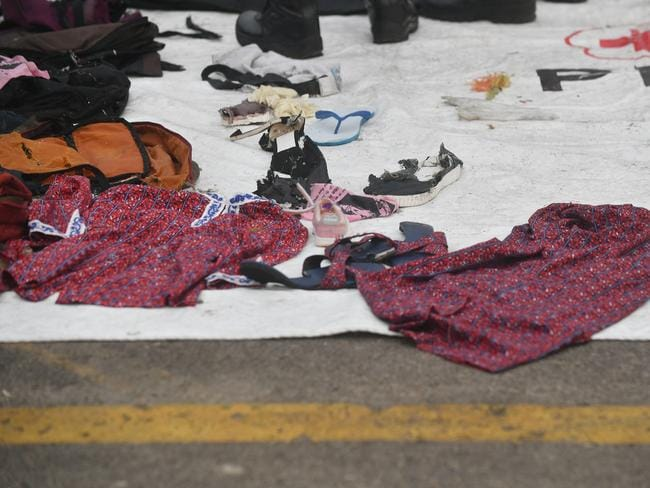 A Lion Air flight attendant's uniform displayed among debris from the crash site. Picture: Adek Berry/AFP