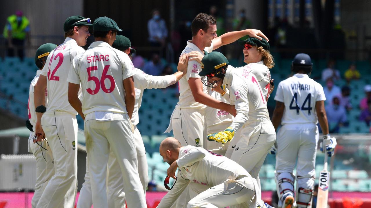 Australia's Josh Hazlewood celebrates the dismissal of Indian batsman Hanuma Vihari . (Photo by Saeed KHAN / AFP)