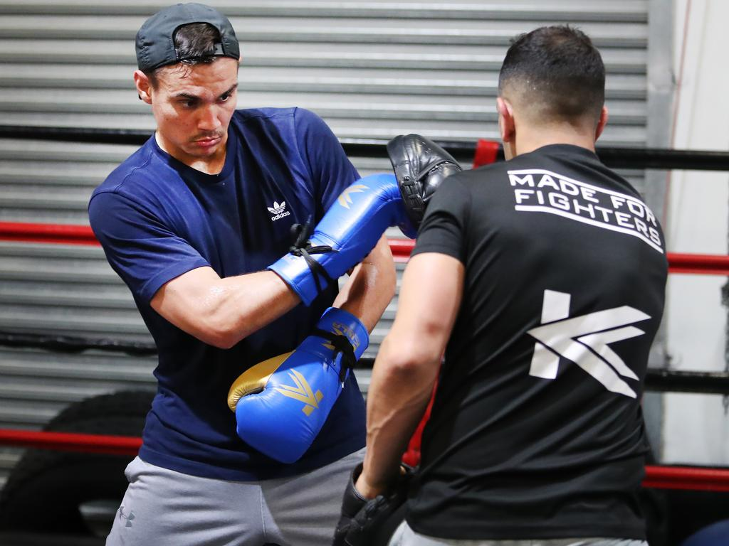 Tim Tszyu works the pads during a training session.