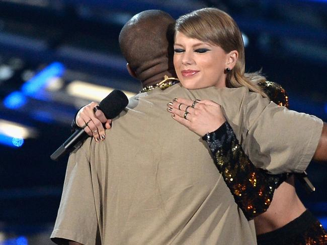 Happier times: Kanye West accepts an award from Taylor Swift during the 2015 MTV Video Music Awards.
