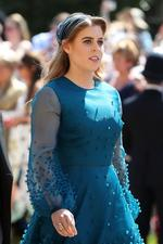 "<p><a href=""https://www.vogue.com.au/fashion/news/princess-beatrice-and-princess-eugenie-have-arrived-at-the-royal-wedding-in-unexpected-outfits/news-story/6f4613865f4f7f1eb3a20d5f56eb9b31"" rel=""noopener"" target=""_blank"">Princess Beatrice</a> arrives at St George's Chapel at Windsor Castle .</p>  <p>Image credit: AFP</p>"