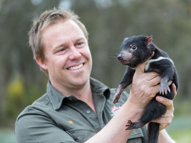 Aussie Ark general manager Tim Faulkner with a joey Tasmanian devil.