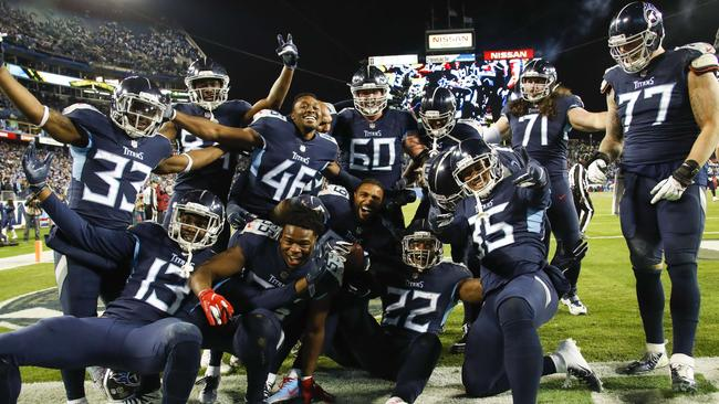 Derrick Henry (No.22) celebrates a touchdown with his Titans teammates. Picture: AFP