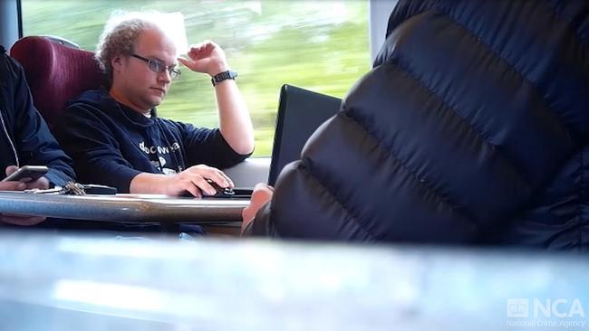 A still taken from surveillance footage of Matthew Falder on a train.