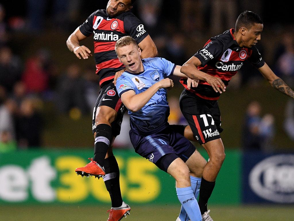 Trent Buhagiar of Sydney competes for possession with Tarek Elrich  (left) and Keanu Baccus of the Wanderers during the FFA Cup Semi Final between the Western Sydney Wanderers and Sydney FC at Panthers Stadium in Sydney, Saturday, October 6, 2018. (AAP Image/Dan Himbrechts) NO ARCHIVING, EDITORIAL USE ONLY